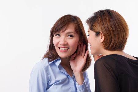 woman gossiping, whispering, listening to rumor or hearsay