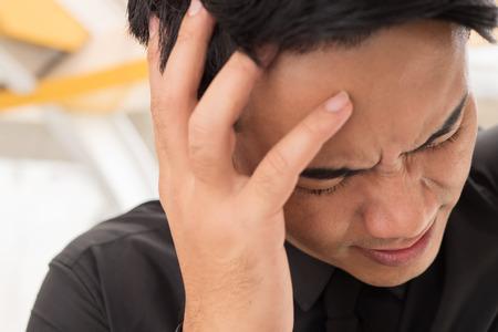 headaches: sick businessman suffering from stress, headache, vertigo, migraine, emotional problem