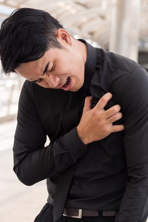 business man suffering heart attack