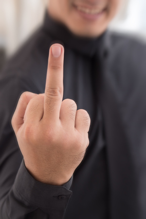 man showing middle finger, rude hand sign Stock Photo