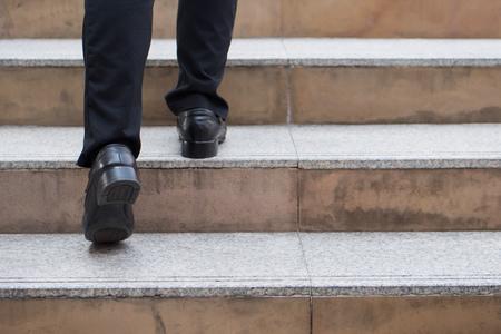 businessman steps up to success