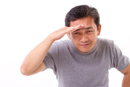 old, middle aged asian man looking, searching, watching at you, studio isolated