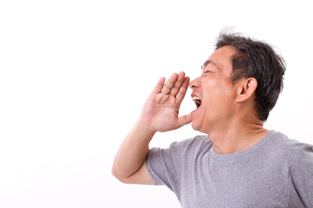 exited middle aged man senior uncle shouting, speaking, advertising, communicating to blank space