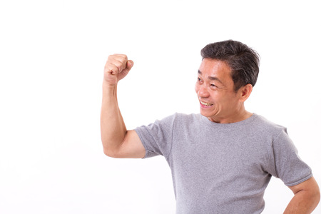 Sterke oude of middelbare leeftijd man geïsoleerd op wit Stockfoto