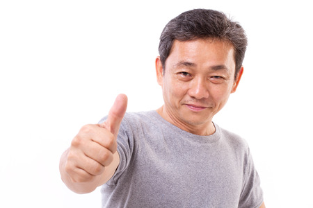 happy, successful, positive middle aged man showing thumb up