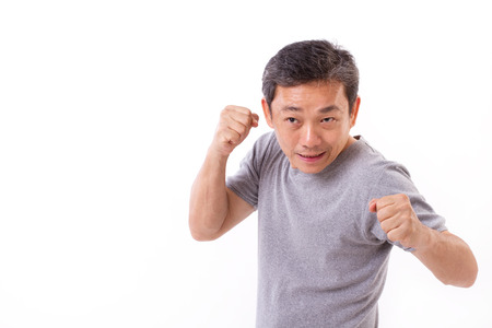 active strong middle aged man punching, fighting