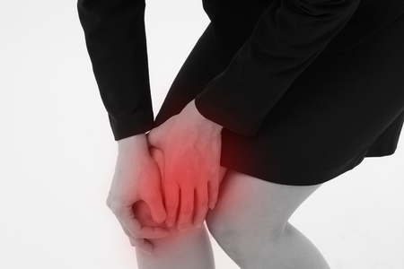 stiff: woman suffering from knee joint pain, injury, gout, arthritis