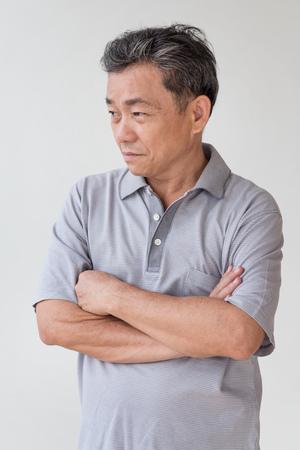 serious, stressed old senior man looking away