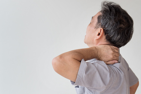 back ache: man suffering from neck, shoulder pain Stock Photo