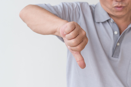 rejecting, angry, negative, displeased senior old man showing thumb down