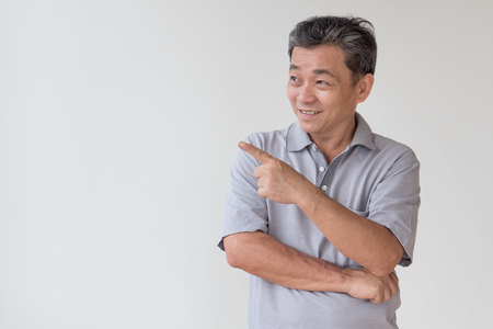 old, middle aged, senior asian man looking and pointing finger away gesture