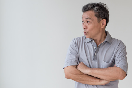exited, confident, happy smiling old senior or middle age asian man looking away to blank space Stock Photo