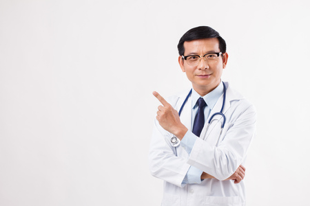 male doctor pointing finger up away to the left side