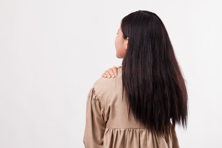 woman with shoulder or neck pain, stiffness, injury Stock Photo