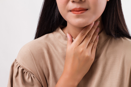 sick woman with sore throat Stock Photo