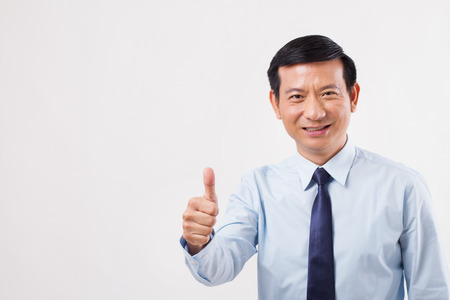 Businessman pointing up thumb up gesture Stock fotó