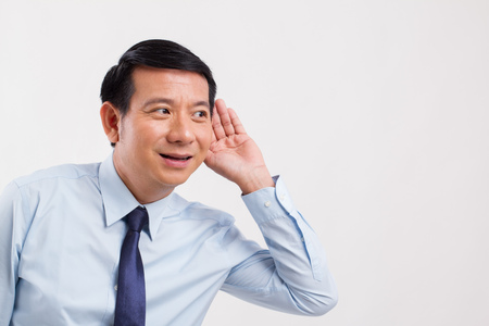 happy smiling positive business man listening to good news Stock Photo