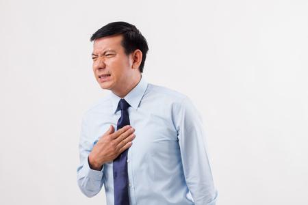 sick man suffering from acid reflux, gerd, heartburn, indigestion Stock Photo