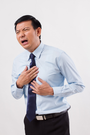sick man suffering from acid reflux, gerd, heartburn, indigestion Stockfoto