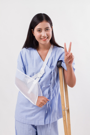 injured woman patient pointing up victory 2 fingers gesture