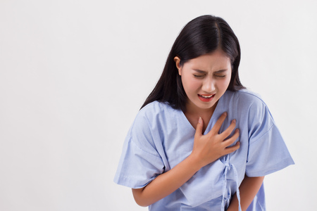 woman patient suffering from heart attack