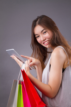 happy woman enjoying online shopping, order placement