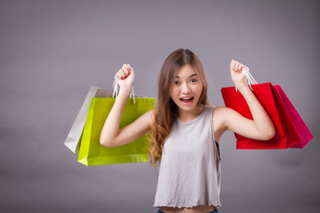 woman holding shopping bag, happy exited grand sale shopper