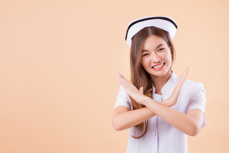 friendly nurse saying no, crossing arms