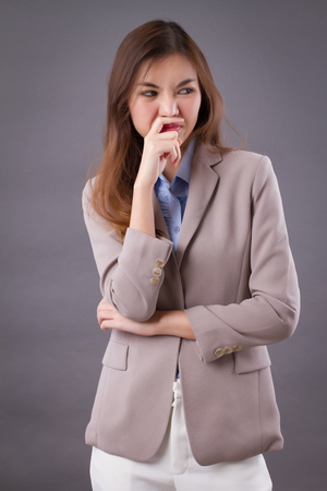frowning upset woman suffering from stinking bad smell Stock Photo