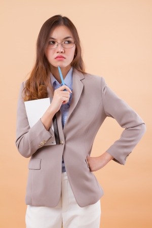 portrait of upset, angry, frustrated asian business woman