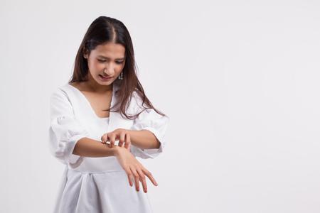 itching woman scratching her skin Standard-Bild