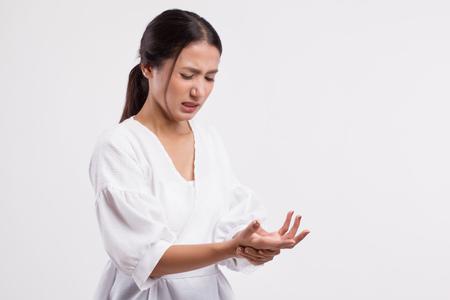 vrouw die lijdt aan triggervinger, cps, polsgewrichtspijn, artritis, jicht Stockfoto
