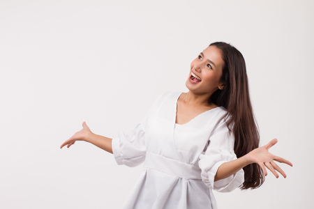 excited asian woman looking up