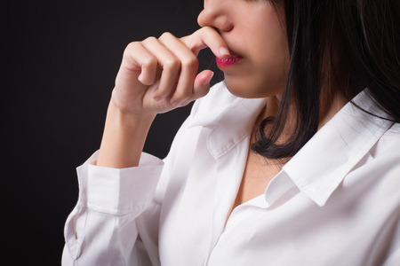 woman catching a cold, runny nose