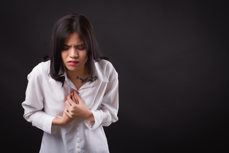 sick stressed woman with acid reflux, gerd symptoms Stock Photo