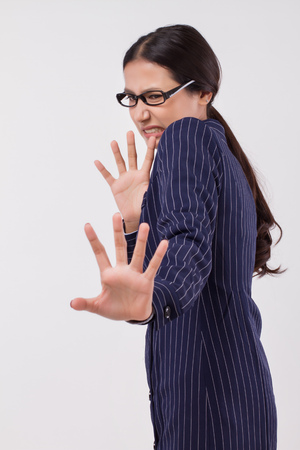 frightened business woman saying no