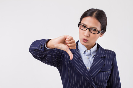 asian business woman showing thumb down Stock Photo