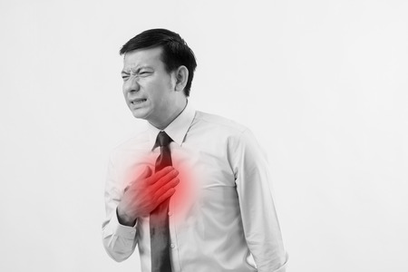 sick man suffering from acid reflux, gerd, heartburn, indigestion Stockfoto
