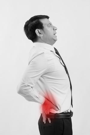 business man suffering from back pain, spinal injury Stock Photo