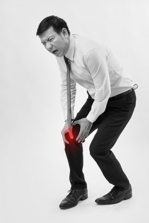 man suffering from knee joint pain Stock Photo