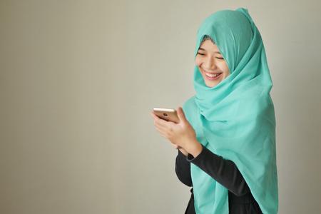 happy exotic woman using smart phone