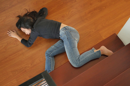 soman falling down, dangerous situation, bad day, injury, insurance concept Stock Photo
