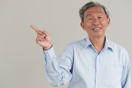 old man pointing up gesture