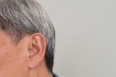 senior old man listening, hearing problem or receiving information Foto de archivo