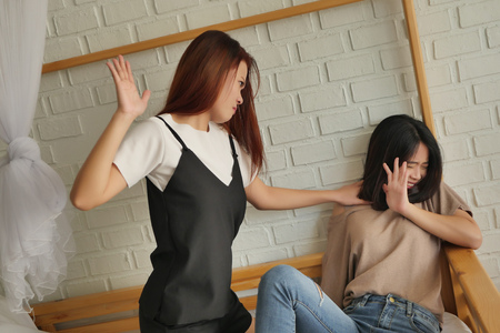 two women fighting, slapping, hitting, catfight, concept of domestic violence,  physical assault crime