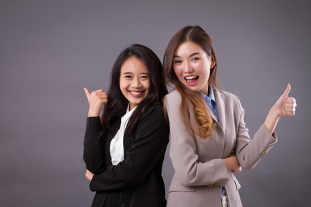 smiling laughing successful business team giving thumb up gesture
