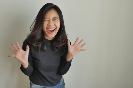 happy excited asian woman laughing