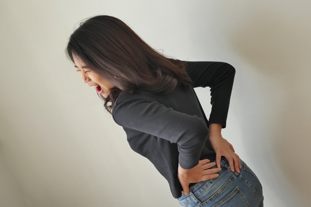woman suffering from back pain, girl with backbone or spinal muscle injury