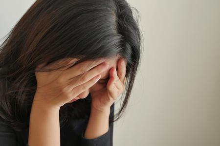 girl face palm gesture, depressed woman Foto de archivo