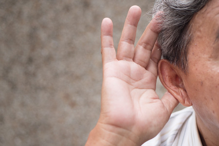 senior old man listening or hearing information